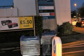Tesco use shopping trolley barricade to block Castle Street exit after storm Brendan tilts  huge sign